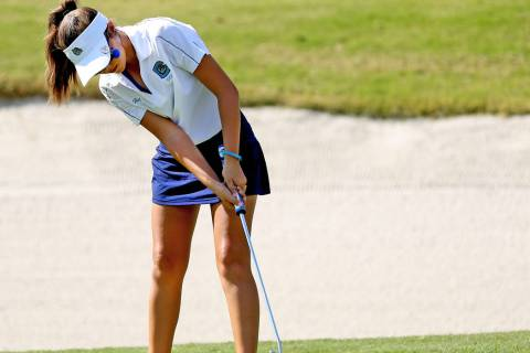 Centennial's McKenzi Hall completes hole six during the 4A State Golf Championship at ...