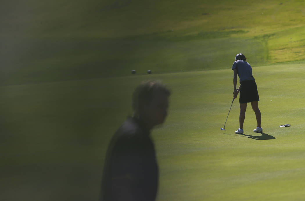 Clark's Riana Mission putts during the Class 4A state girls golf tournament at Highlan ...