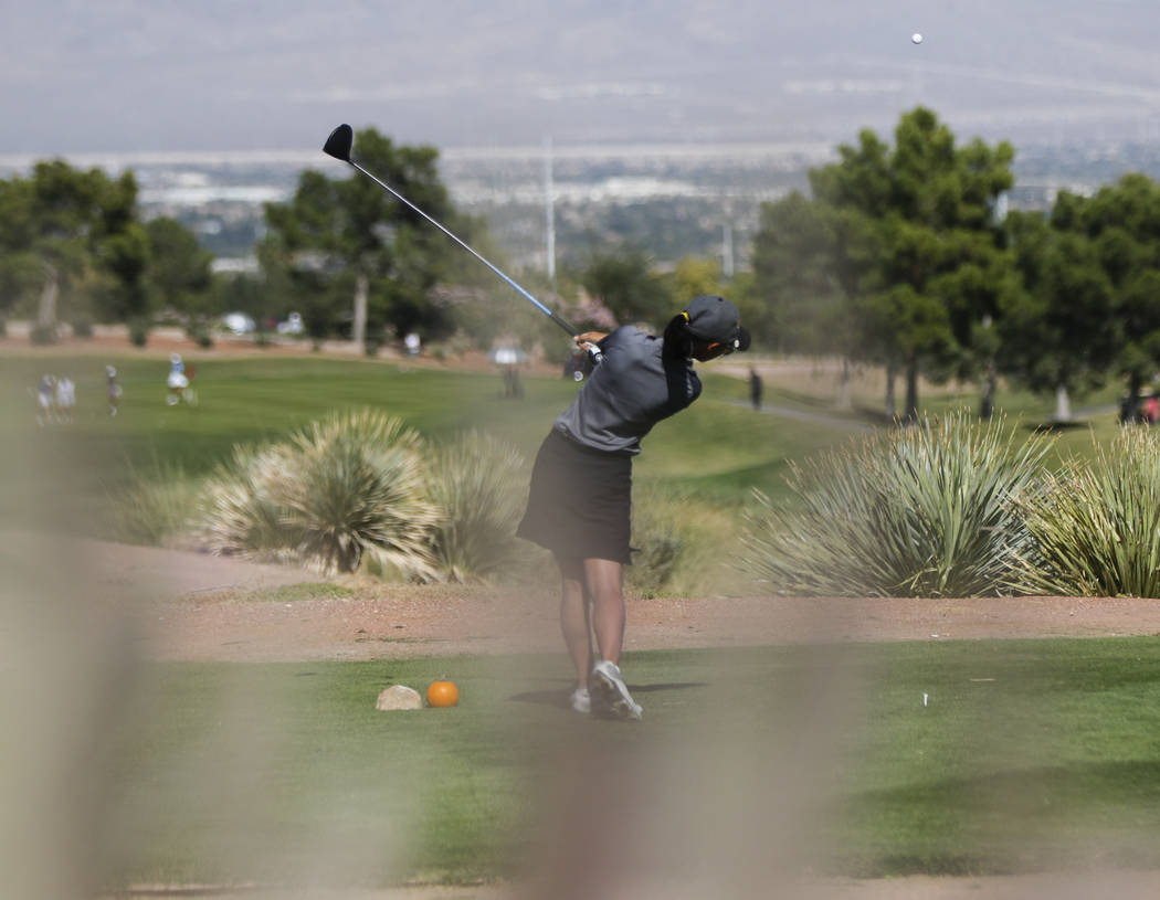 Clark's Riana Mission watches her tee shot during the Class 4A state girls golf tourna ...
