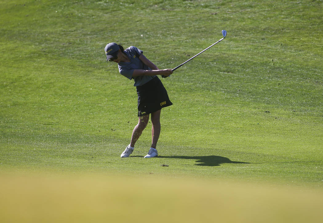 Clark's Riana Mission swings during the Class 4A state girls golf tournament at Highla ...