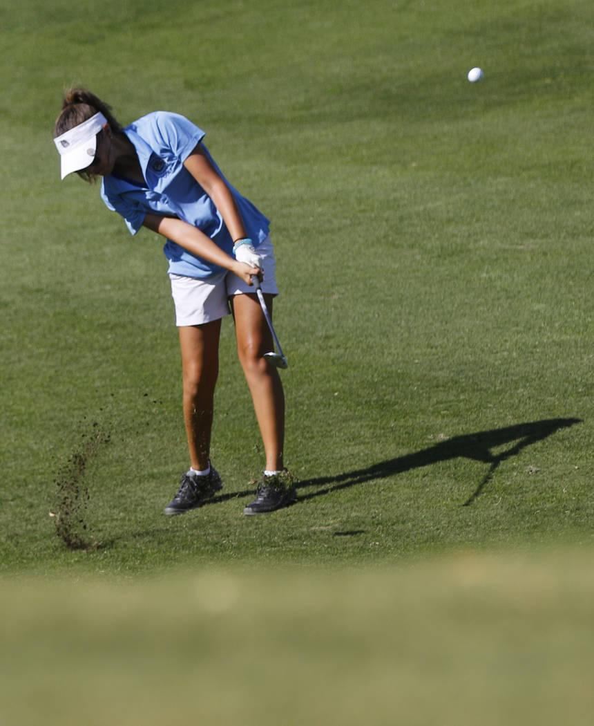Centennial's McKenzi Hall swings during the Class 4A state girls golf tournament at Hi ...