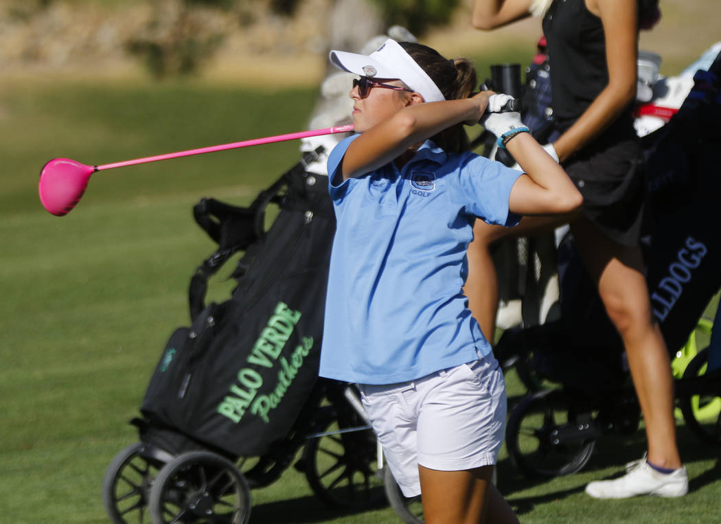 Centennial's McKenzi Hall watches her tee shot during the Class 4A state girls golf to ...