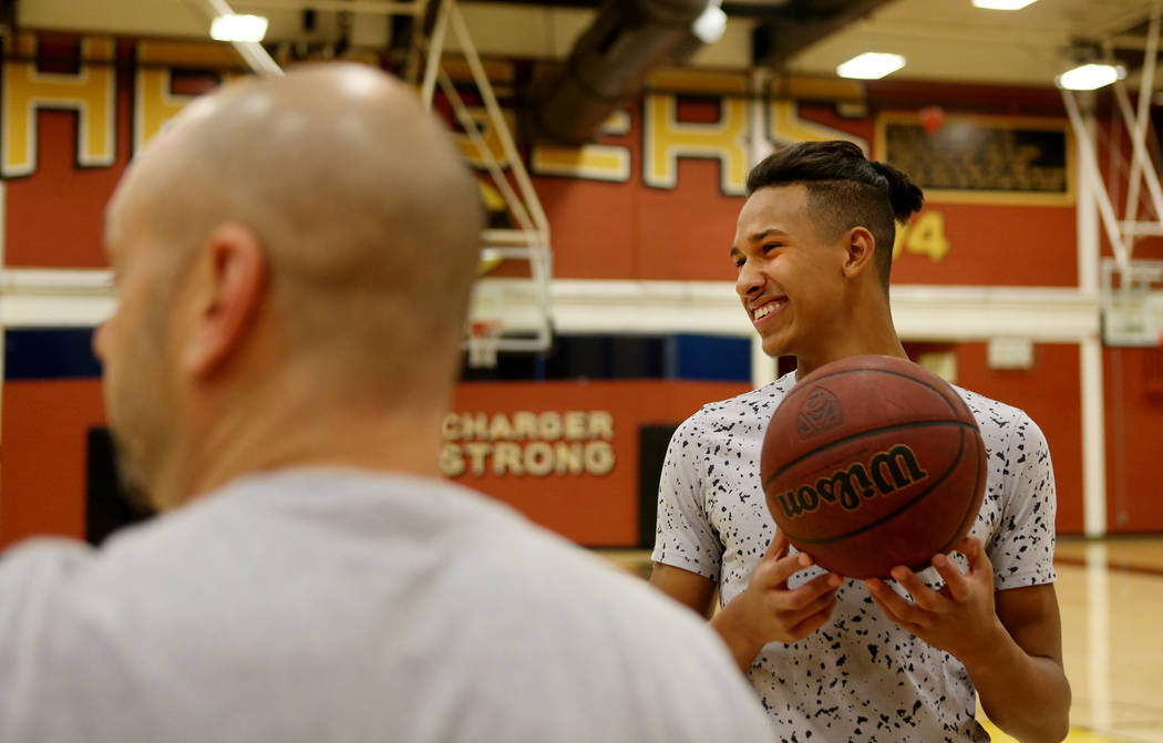 Clark High School senior Greg Foster speaks with coach Chad Beeten during basketball practic ...