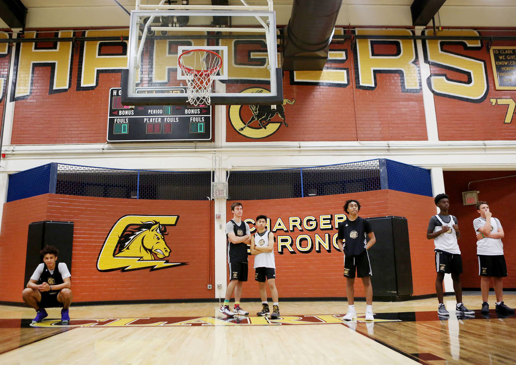 Players on the Clark High School basketball team line up for drills during basketball practi ...