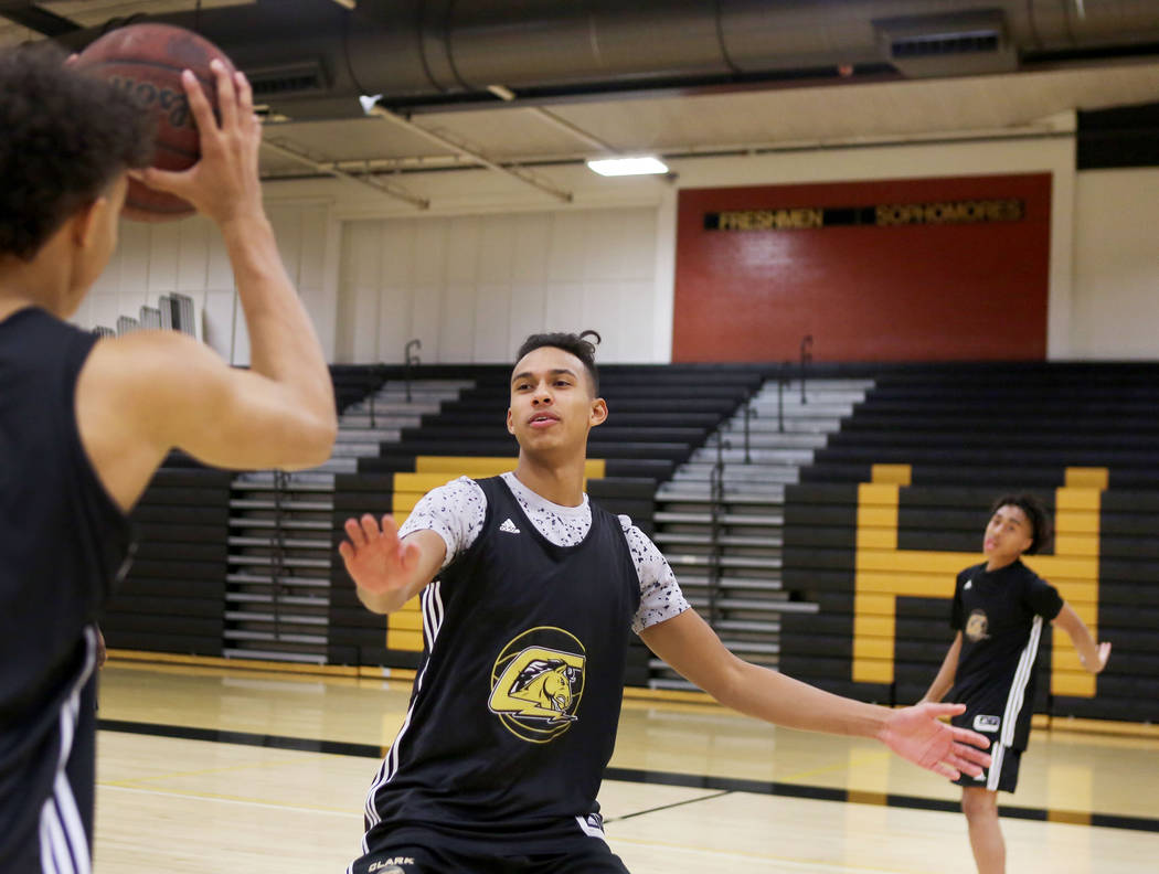 Clark High School senior Greg Foster guards during basketball practice at Clark High School ...
