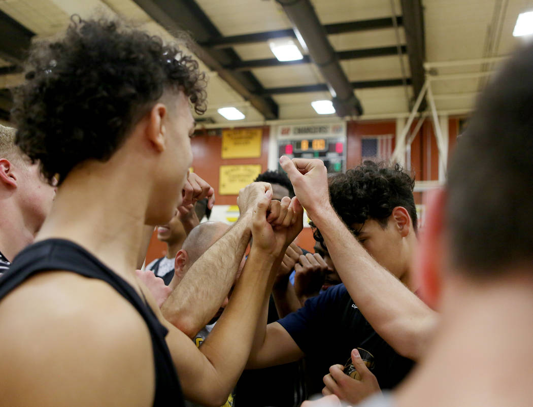 Players on the Clark High School basketball team break for basketball practice at Clark High ...