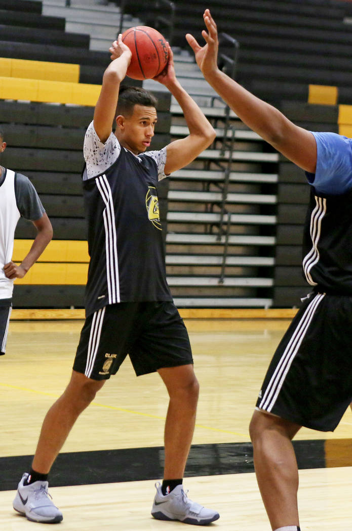 Clark High School senior Greg Foster passes the ball during basketball practice at Clark Hig ...