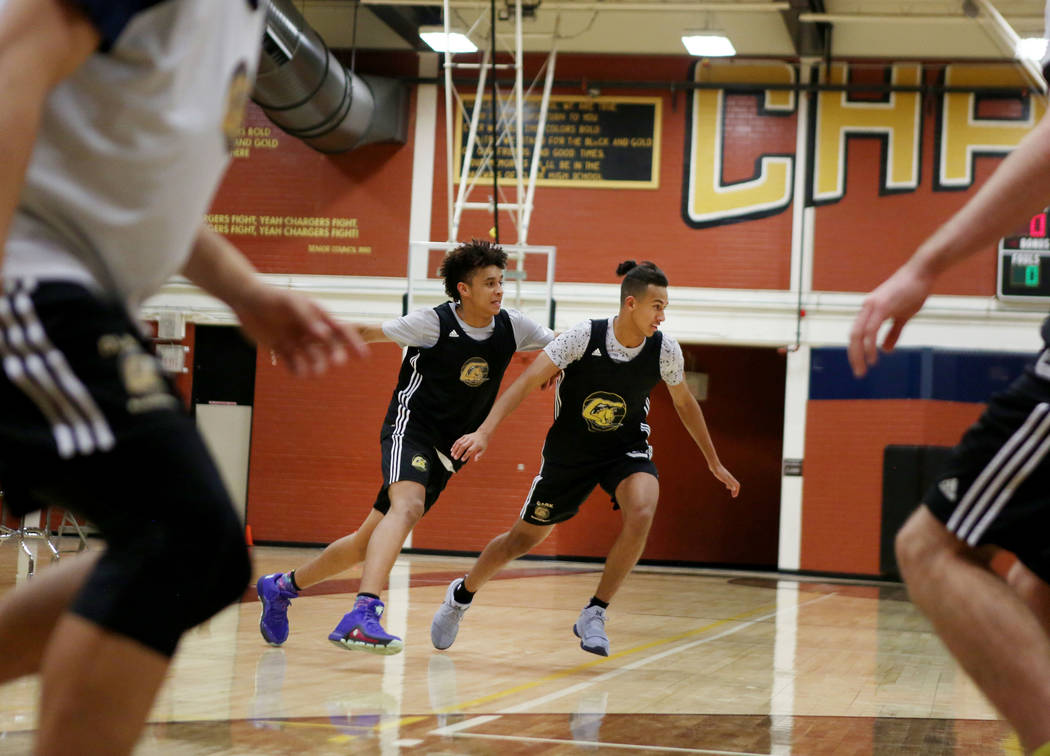 Jalen Hill, left, and Greg Foster, participate in drills during basketball practice at Clark ...