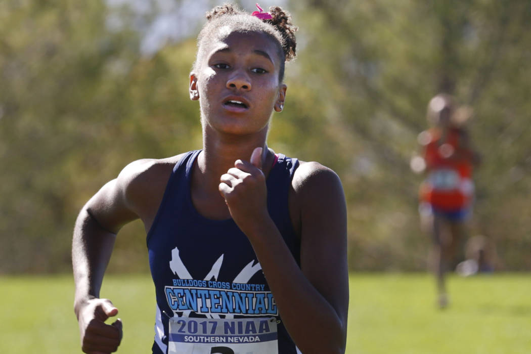 Centennial's Alexis Gourrier (2) competes during the Girls Cross Country Class 4A Suns ...