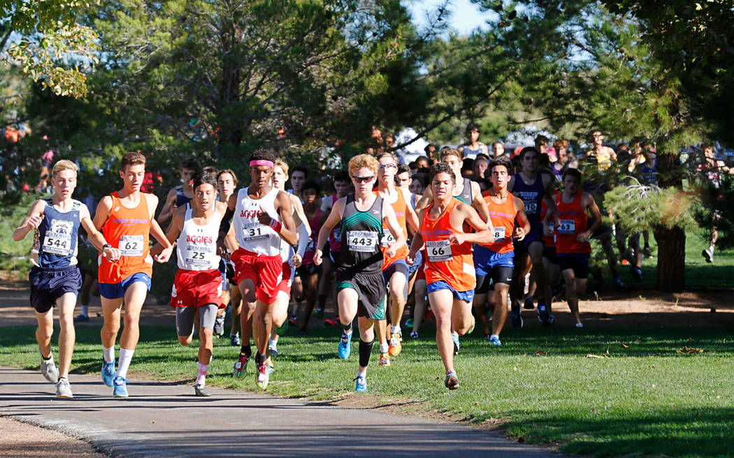 Runners compete during the Boys Cross Country Class 4A Sunset Region race in Boulder City, F ...