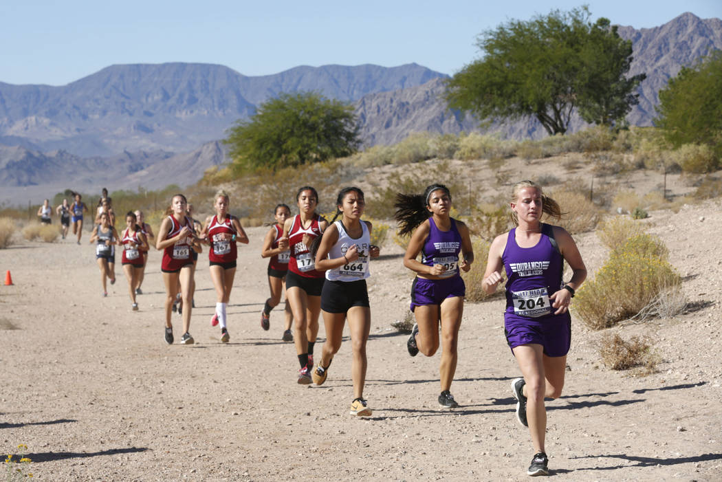 Runners compete during the Girls Cross Country Class 4A Sunset Region race in Boulder City, ...