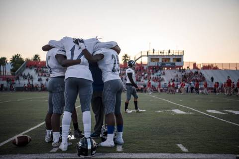 Desert Pines football players pray before the game at Arbor View High School on Friday, Sep. ...