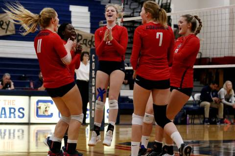 Coronado teammates celebrate after scoring a point against Foothill during the Class 4A Sunr ...