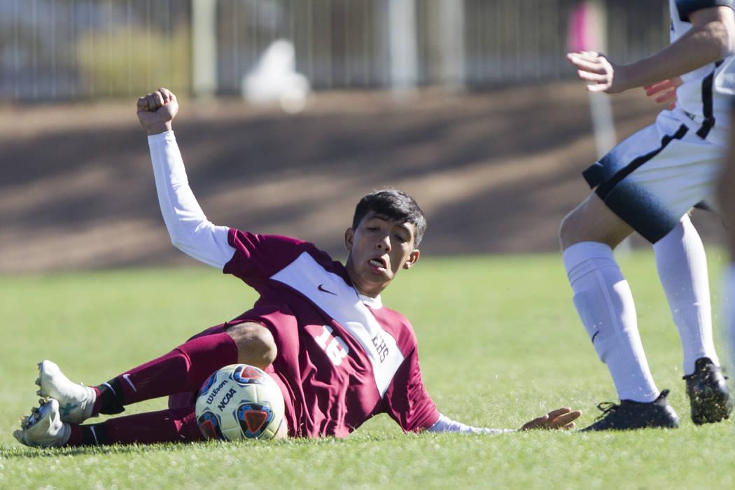 Eldorado's Cipriano Rodriguez (18) slides for the ball against Coronado in the Sunrise ...