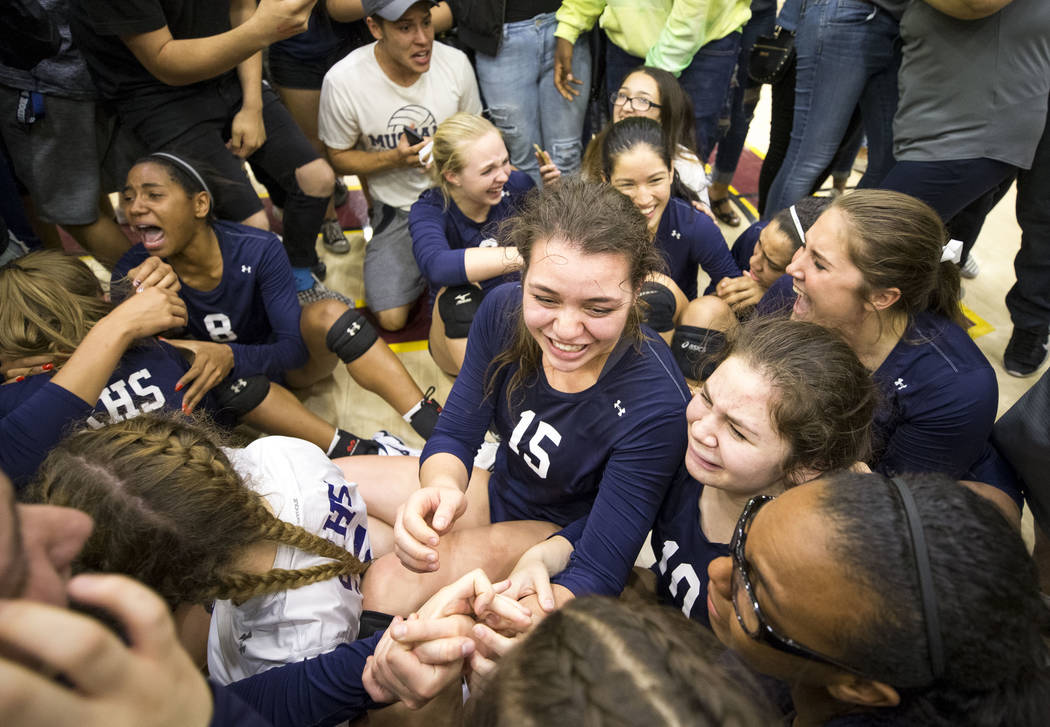 Shadow Ridge senior Whittnee Nihipali (15) celebrates with her teammates after defeating the ...