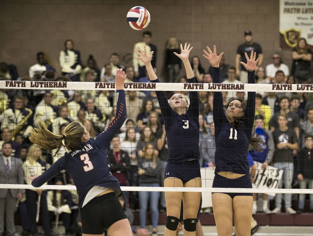Gorman's Tommi Stockham (3) tips the ball over Shadow Ridge's Madison Norr (3) a ...