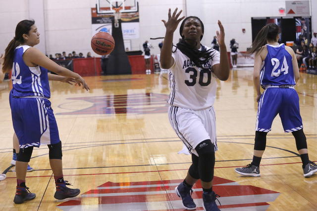 Agassi Prep's Sharmayne Finley (30) reacts after the ball is knocked from her hands du ...