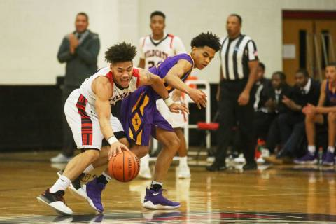 Las Vegas player Donovan Joyner (12) and Durango player Anthony Hunter (21) fight for the ba ...