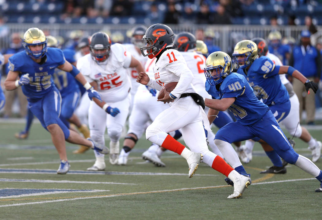 Bishop Gorman's Micah Bowens runs against Reed in the NIAA 4A state championship foot ...