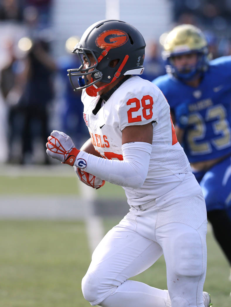 Bishop Gorman's Amod Cianelli runs against Reed in the NIAA 4A state championship foo ...