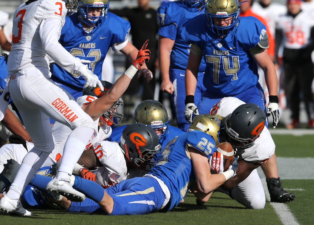 Bishop Gorman and Reed players fight for a loose ball during the first half of the NIAA 4A s ...
