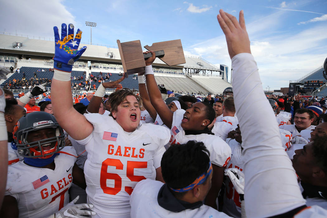 Bishop Gorman celebrates their 48-7 victory over Reed for the NIAA 4A state championship in ...