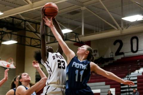 Desert Oasis' Desi-rae Young (23), left, and Foothill's Kaylee Hall (11), right, ...