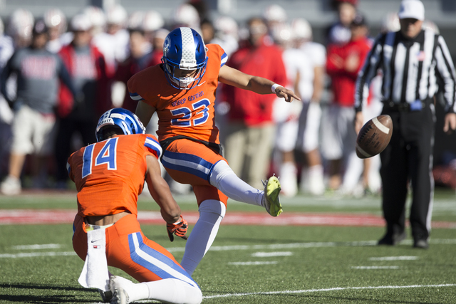 Bishop Gorman's Derek Ng (23) kicks the ball for an extra point against Liberty in the ...