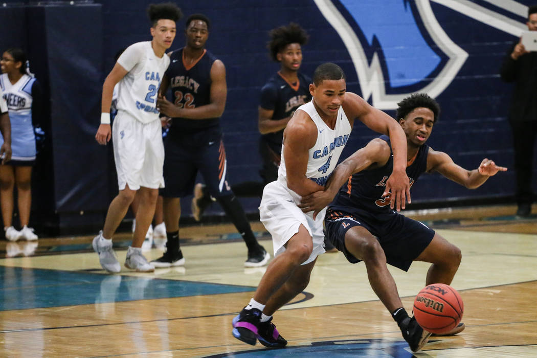 Canyon SpringsՠKevin Legardy (4), left, and Legacyճ Cristian Pitts (3), right, r ...