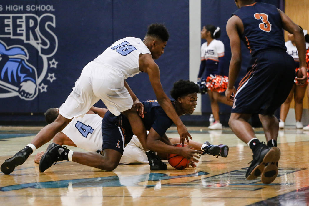 Legacyճ Cristian Pitts (3), center, jumps for the ball as Canyon SpringsՠChristo ...