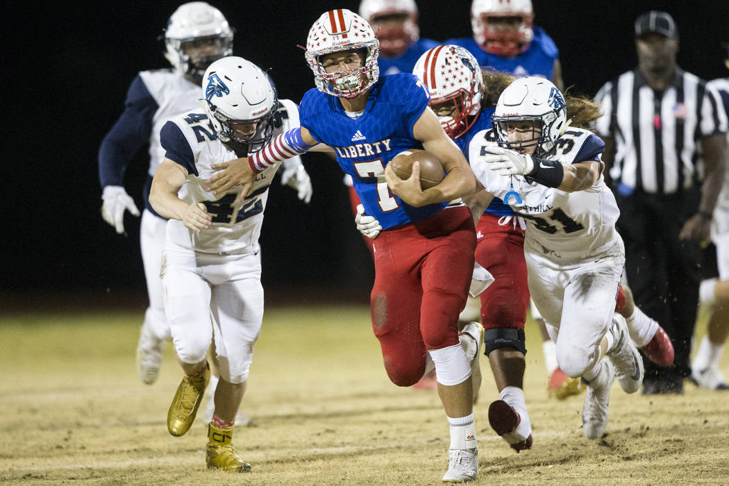 Liberty's Kenyon Oblad (7) runs the ball against Foothill in their football game at Li ...