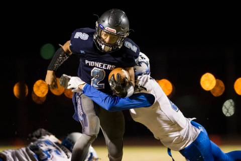 Canyon Spring's DiaMante Burton (2) runs the ball against Basic's Franco Mays (1 ...