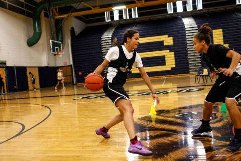 Essence Booker (3) dribbles the ball as she is guarded by a teammate during a basketball pra ...