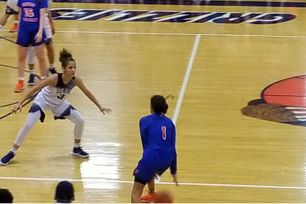 Spring Valley's Essene Booker, left, defends Bishop Gorman's Caira Young on Tues ...