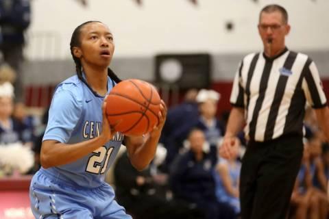 Centennial girls basketball player Justice Ethridge (21) prepares to shoot during a game aga ...