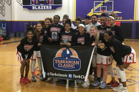 The Liberty girls basketball team poses for a photo after winning the Tarkanian Classic&#821 ...