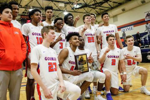 Bishop Gorman holds a trophy after defeating the Clark Chargers 69-56 in the platinum divisi ...
