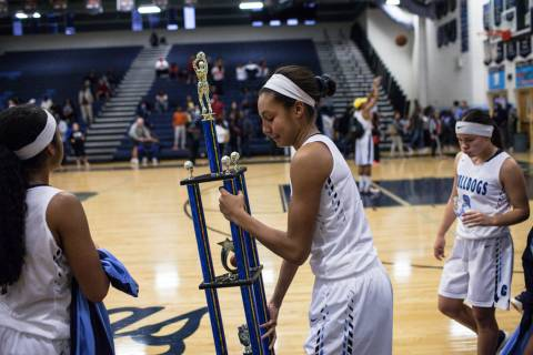 Centennial's Jade Thomas (5) holds the championship trophy after defeating Etiwanda 59 ...