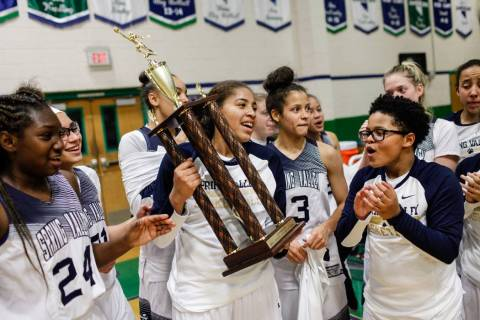 Spring Valley's Kayla Harris (11) holds the championship trophy after defeating Liber ...