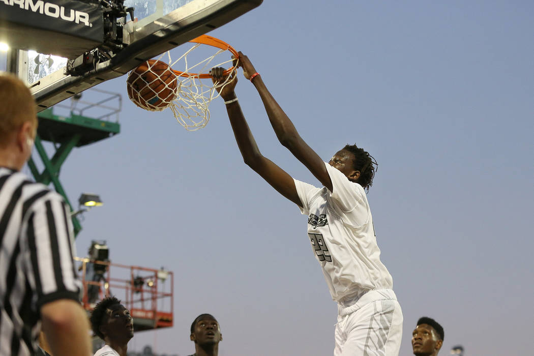 Team Clutch's Bol Bol #22 in action against Team Drive in the Under Armour Elite 24 g ...