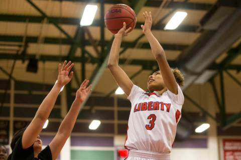 Liberty's Journie Augmon (3) goes up for a shot against Bonita Vista in the girl&#8217 ...