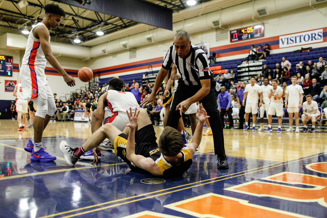 A referee calls a personal foul on Clark Chargers' Adam Forbes (24) after he fouled Bi ...