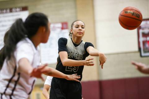 Spring Valley's Alexus Quaadman (23) passes the ball during a basketball game at Deser ...