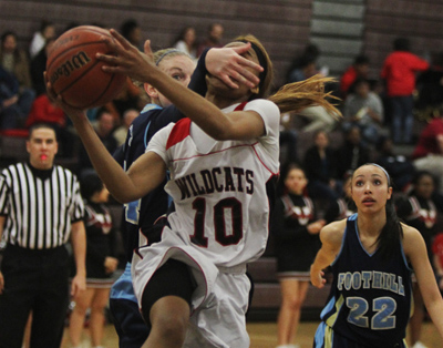 Las Vegas' Shomari Harris (10) gets fouled by Foothill's Gabby Doxtator while dr ...