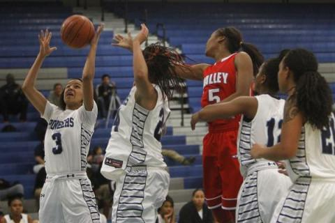Canyon Springs' Cherise Beynon (3) grabs a rebound while taking on Valley on Tuesday.