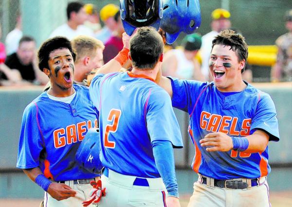 Bishop Gorman's Michael Blasko, right, celebrates his three-run home run with teammate ...
