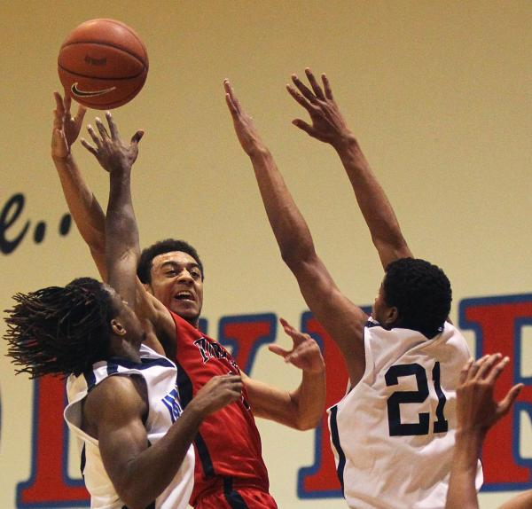 Nigel Williams-Goss, center, is Findlay Prep's first four-year player and the Pilots' se ...