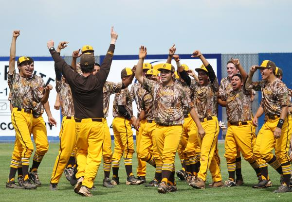 Bonanza coach Derek Stafford, on left in brown shirt, joins his players to celebrate Friday ...