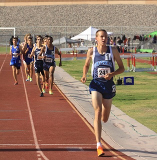 Centennial Bulldogs 1600 meter runner Nick Hartle already has a large lead over his competit ...