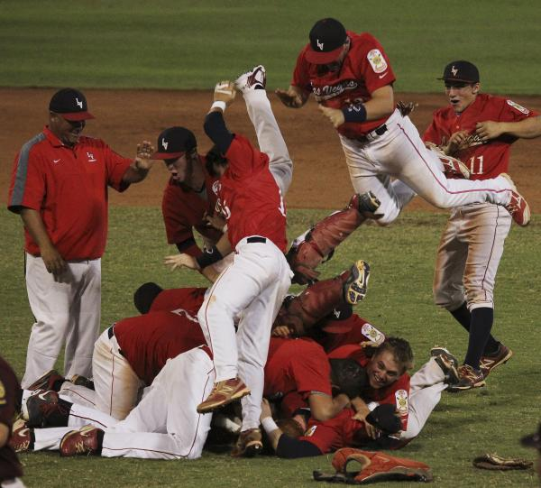 Liberty's baseball team celebrates Saturday after clinching its second straight American L ...
